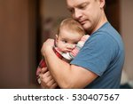 the father holds on hands of... | Shutterstock . vector #530407567