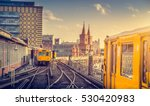 Stock photo panoramic view of berliner u bahn with oberbaum bridge in the background in golden evening light at 530420983