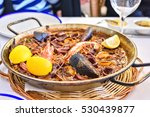 tasty seafood paella in black... | Shutterstock . vector #530439877