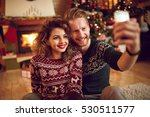 couple photographing christmas... | Shutterstock . vector #530511577