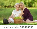 Elderly Woman And Young Woman...