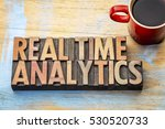 Small photo of real time analytics word abstract in vintage letterpress wood type
