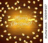 vector christmas lights on wood ... | Shutterstock .eps vector #530549107