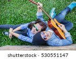 hipster man playing guitar for... | Shutterstock . vector #530551147