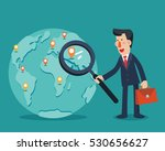 businessman holding magnifying... | Shutterstock .eps vector #530656627