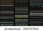 Seasonal ornaments. Doodle patterns. Decorative design elements. Ribbon, border, divider, pattern, symbol set. Hand drawn brush strokes, lines on charcoal background.     Shutterstock vector #530707963