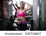 Small photo of young fitness woman tired in gym with sportive nutrition , Amino Acid or bcaa of shaker