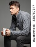 sexy young man in warm knit... | Shutterstock . vector #530757847
