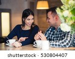 young couple talking in coffee... | Shutterstock . vector #530804407