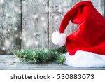 santa claus hat and xmas tree... | Shutterstock . vector #530883073