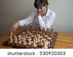Portrait Of A Boy Playing Chess