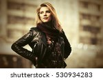 young blond woman in leather... | Shutterstock . vector #530934283