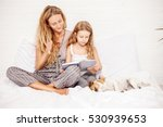 woman with child reading book.... | Shutterstock . vector #530939653