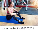 Young Woman Sitting On A Mat A...