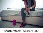 close up of a woman tying her... | Shutterstock . vector #531071287