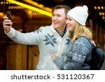 christmas bazaar. the young... | Shutterstock . vector #531120367