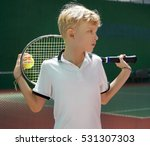 Small photo of Teenage Caucasian boy holding a tennis racket and ball. Active and healthy lifestyle concept. Summer sport activities .
