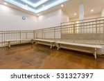 Small photo of Modern sauna or spa interior with passages to steam rooms, wooden benches for relaxation, great amenities.