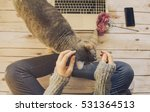 Stock photo girl with a cat working at home 531364513