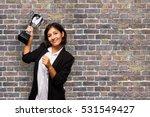 latin business woman holding a... | Shutterstock . vector #531549427