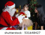 Santa Claus And Mother With...