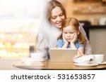 relaxing in cafe   Shutterstock . vector #531653857