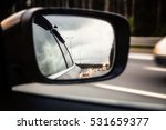 Road Reflected In Side Mirror...