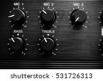 black volume knob panel...