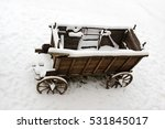 The Old Wooden Cart In The Snow