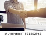 Small photo of Great job,Sealing a good deal,Successful business,Handshake,Two business man holding and shaking hands standing at the working place in office,selective focus,Vintage tone,copy space