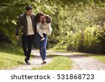family of three on a walk ... | Shutterstock . vector #531868723