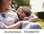 mother tickling her daughter ... | Shutterstock . vector #531868747