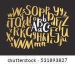 female gold lettering alphabet. ...