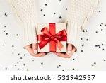 female hands holding present... | Shutterstock . vector #531942937