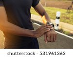 male runner jogging outside... | Shutterstock . vector #531961363