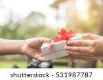 Small photo of Give gift