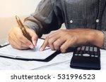finance concept. man writing... | Shutterstock . vector #531996523