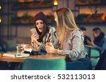 Two Friends Enjoying Coffee...