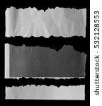 pieces of torn paper on black | Shutterstock . vector #532128553