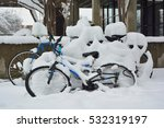 Snow Covered Bicycles In A...