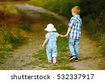 brother and sister walk through ... | Shutterstock . vector #532337917