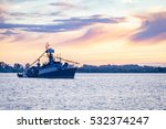 warship on holiday at sunset | Shutterstock . vector #532374247