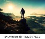 man silhouette stay on sharp... | Shutterstock . vector #532397617