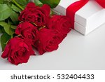 Bouquet Of Red Roses And Gift...