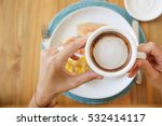 girl having breakfast and a cup ... | Shutterstock . vector #532414117