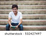 smiling college student sitting ... | Shutterstock . vector #532427497