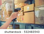 postman worker scanning package ... | Shutterstock . vector #532483543