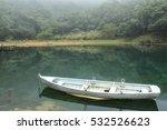 Boat Floating On Lake