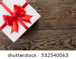 white box with a red bow on the ... | Shutterstock . vector #532540063