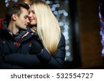 Loving Young Couple On Street